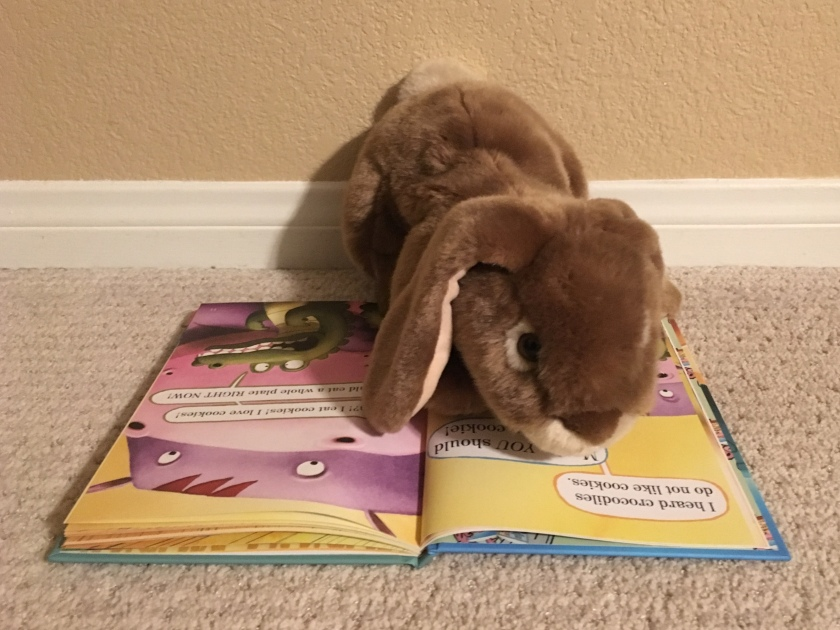 Caramel is reading one of his favorite pages in The Cookies Fiasco by Dan Santat.