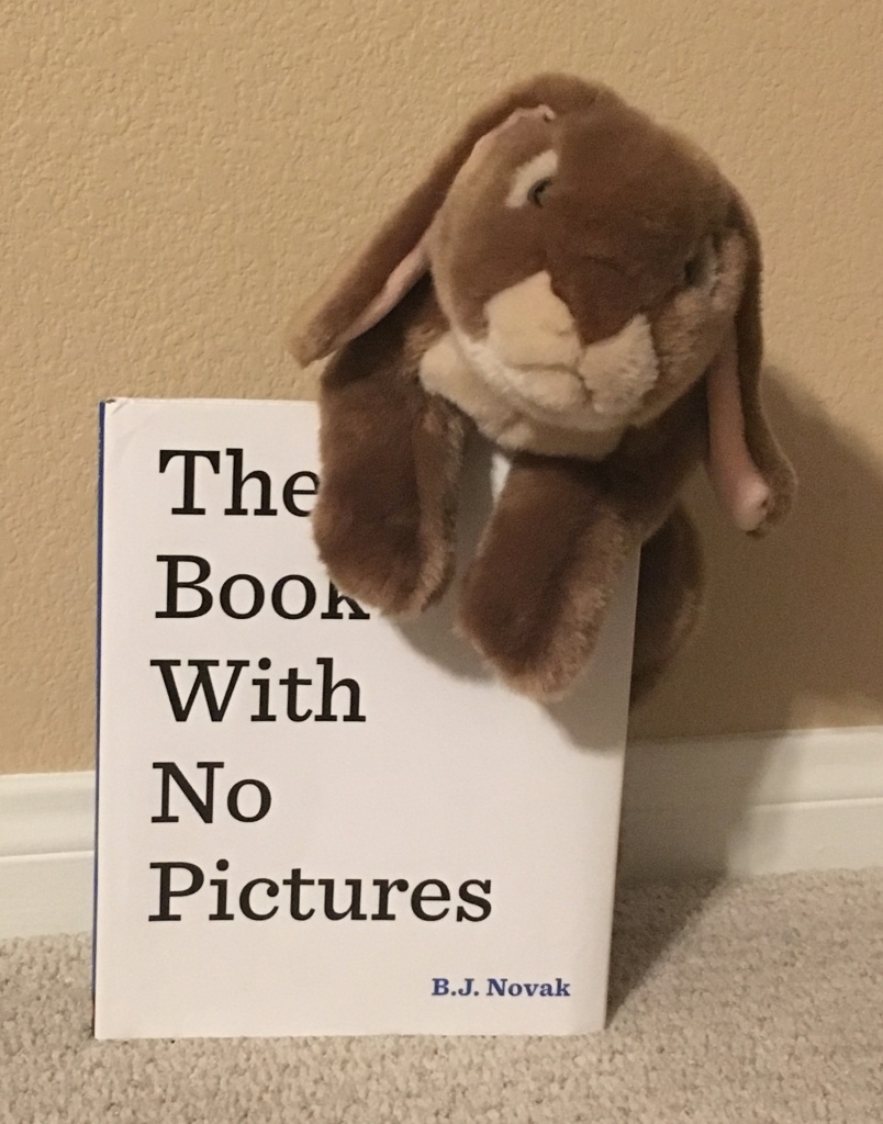 Caramel loves reading and having adults read The Book With No Pictures by B.J. Novak.