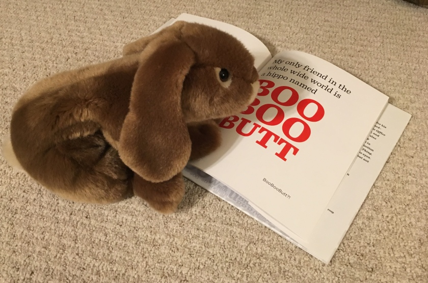 Caramel is rereading one of his favorite pages in The Book With No Pictures by B.J. Novak.