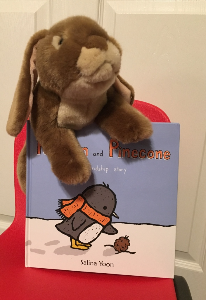 Caramel loves reading and rereading Penguin and Pinecone: A Friendship Story by Salina Yoon.