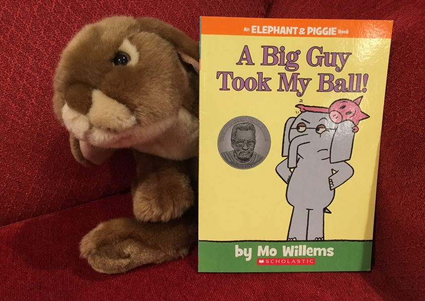 Caramel loves reading and rereading A Big Guy Took My Ball! by Mo Willems.