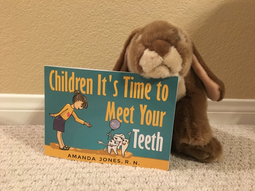 Caramel enjoyed learning more about teeth in Amanda Jones' Children It's Time to Meet Your Teeth.