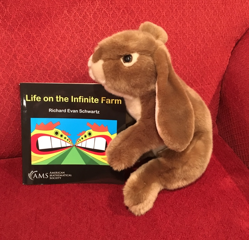 Caramel enjoys reading and rereading bits and pieces of Life on the Infinite Farm by Richard Evan Schwartz.