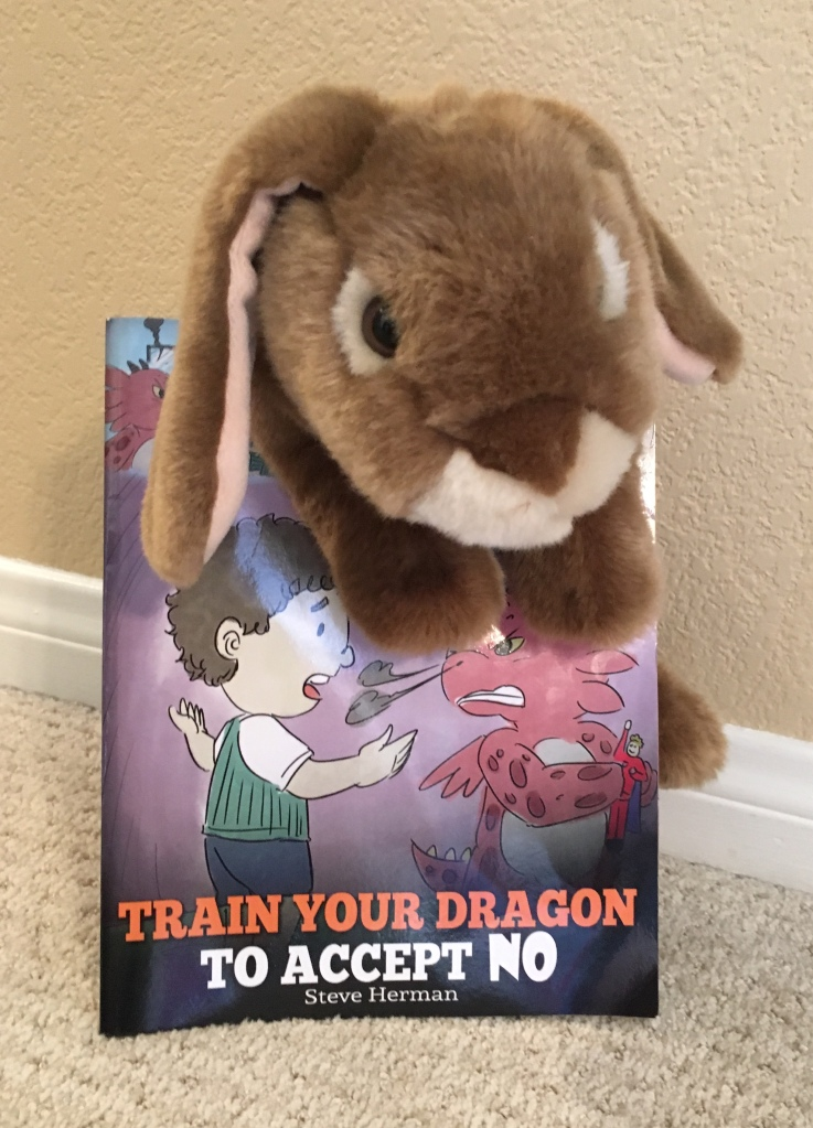 Caramel enjoyed reading Train Your Dragon To Accept NO by Steve Herman and thinks he might actually try the advice given there about calming down when someone says no.