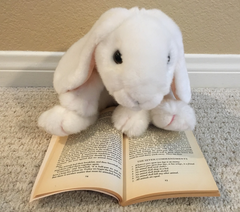 Marshmallow is pointing to the original seven commandments in George Orwell's Animal Farm.
