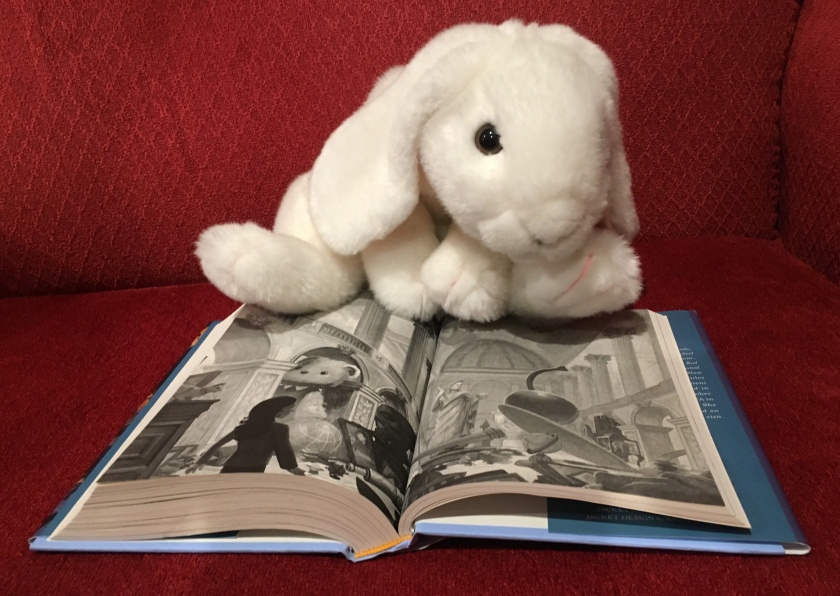 Marshmallow is pointing at a picture from the book, but do not look too carefully if you don't want any further spoilers!