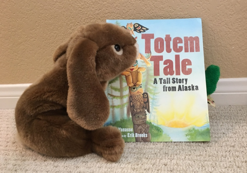 Caramel invited a green friend to read Totem Tale: A Tall Story from Alaska. Can you see him?