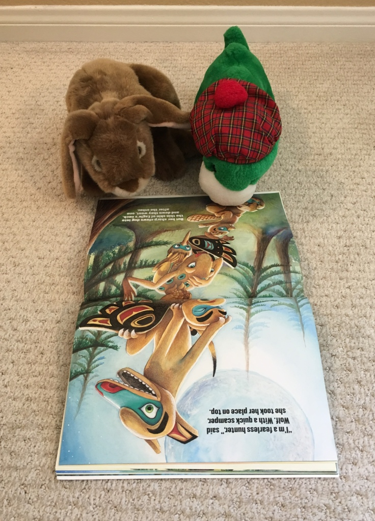 Caramel and his friend the Loch Ness Monster are reading Totem Tale: A Tall Story from Alaska together.
