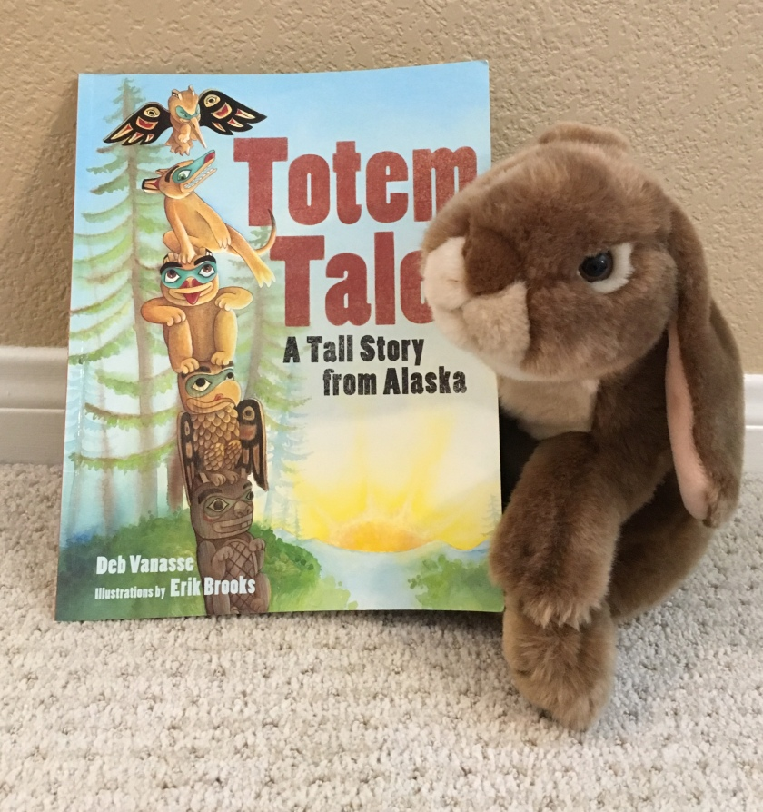 Caramel loves to read and reread Totem Tale: A Tall Story from Alaska written by Deb Vanasse and illustrated by Erik Brooks.