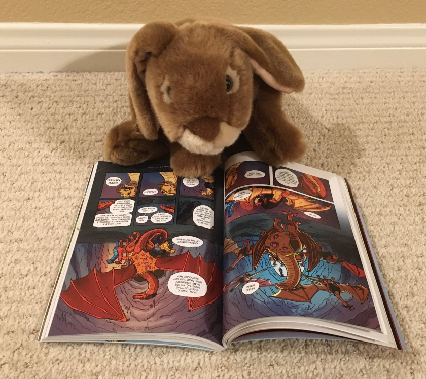 Caramel is enjoying his first real graphic novel: The Dragonet Prophesy (Book One of Wings of Fire) by Tui Sutherland and Mike Holmes.