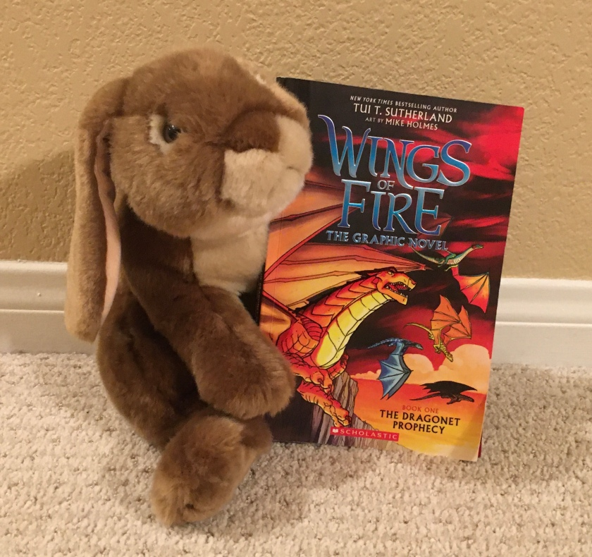 Caramel reviews The Dragonet Prophesy (Book One of Wings of Fire) by Tui Sutherland and Mike Holmes.