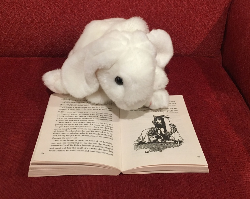 Marshmallow is pointing out one of the many illustrations in Five Children and It by E. Nesbit.