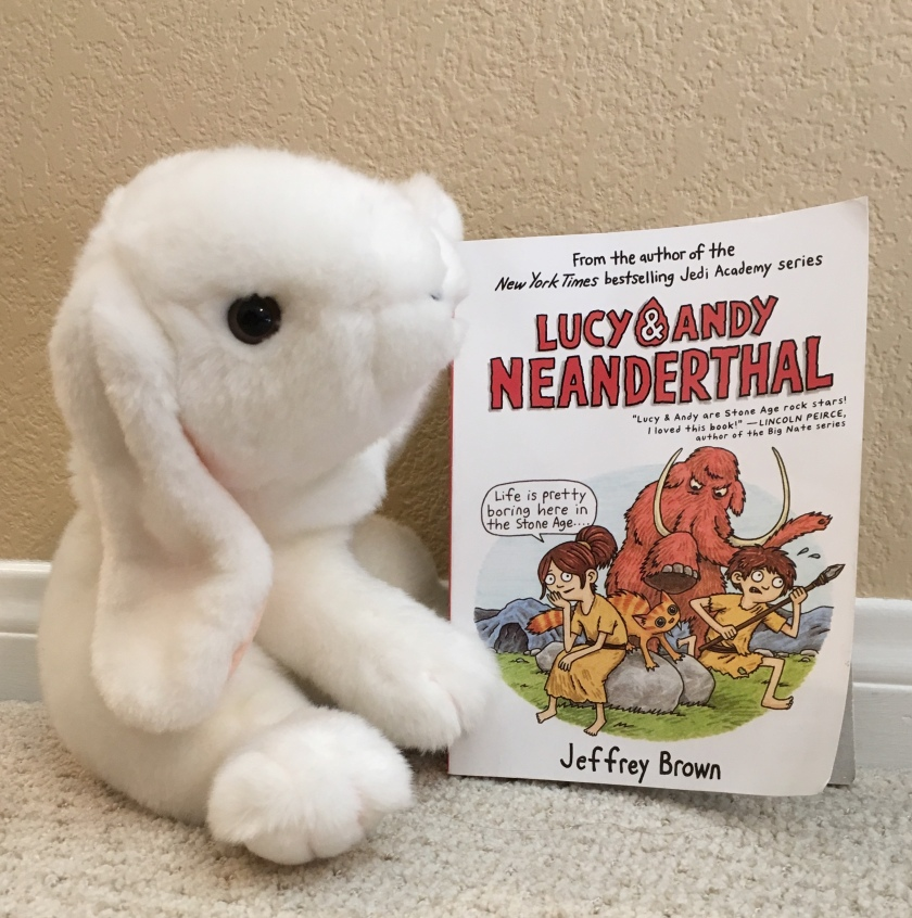 Marshmallow reviews Lucy & Andy Neanderthal by Jeffrey Brown.