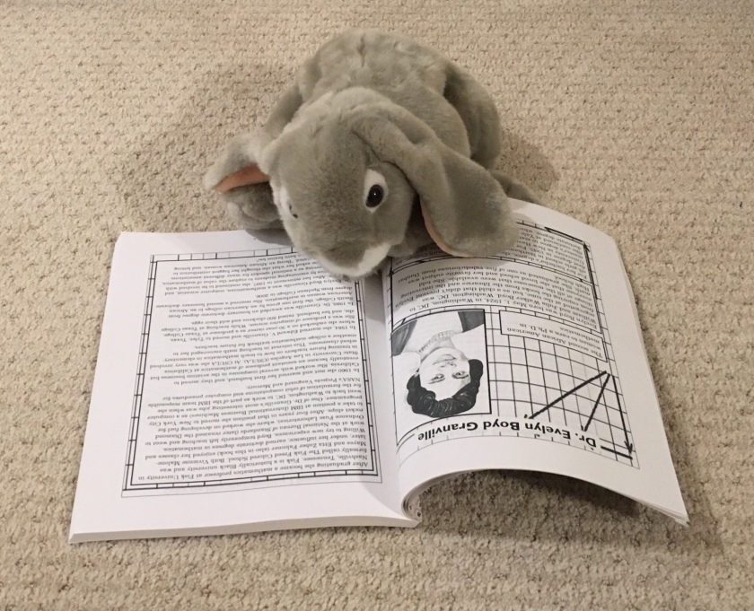 Sprinkles is reading the pages about Dr. Evelyn Boyd Granville, the second African American woman to earn a PhD in mathematics.