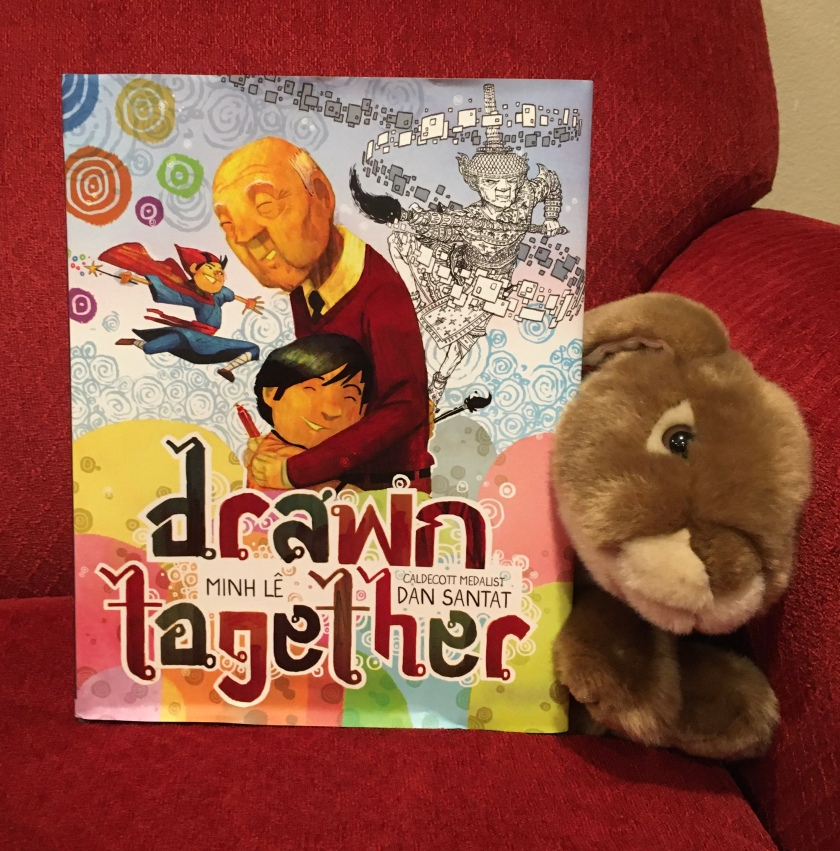 Caramel enjoyed reading Drawn Together, written by Minh Le and illustrated by Dan Santat.