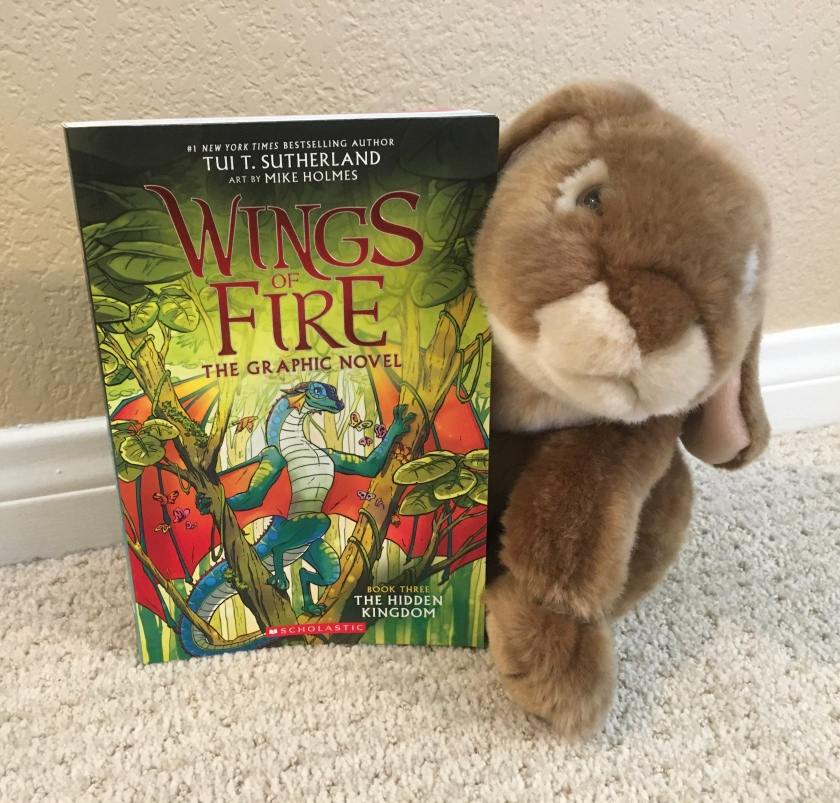 Caramel is still reading and rereading The Hidden Kingdom (Book Three of Wings of Fire) by Tui Sutherland and Mike Holmes.
