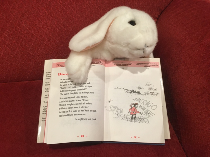 Marshmallow is pointing at one of the poems in BrainJuice: American History, Fresh Squeezed! written in poetic form by Carol Diggory Shields and illustrated by Richard Thompson. This is about Christopher Columbus and his arrival in the Americas.