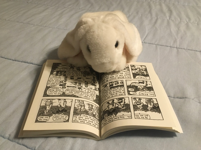 Marshmallow is reading Lucy and Andy Neanderthal: Stone Cold Age by Jeffrey Brown.
