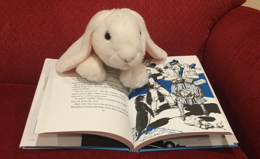 Marshmallow is pointing at one of the illustrations in Mr. Popper's :Penguins, written by Richard and Florence Atwater. The illustrations were made by Robert Lawson.
