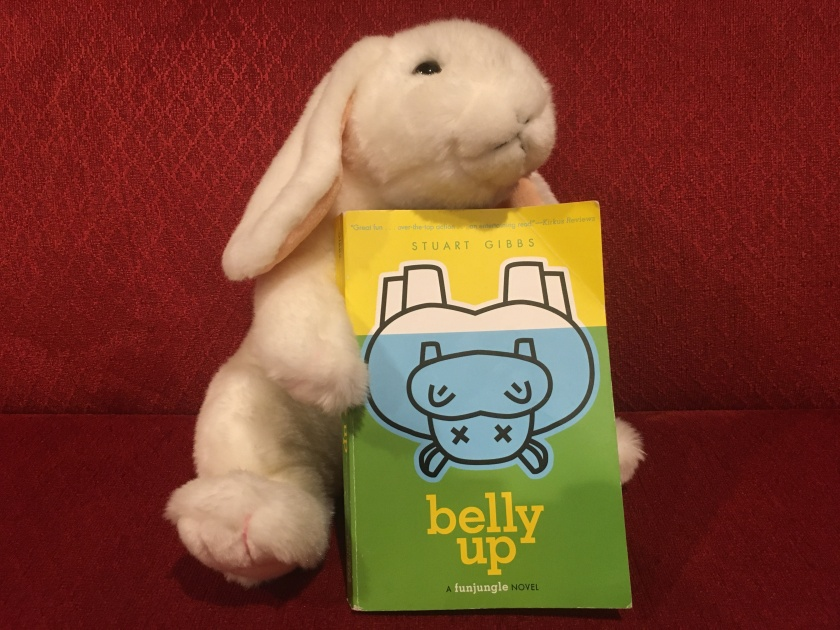 Marshmallow thinks that Belly Up by Stuart Gibbs is one of the best mystery books that she has ever read.