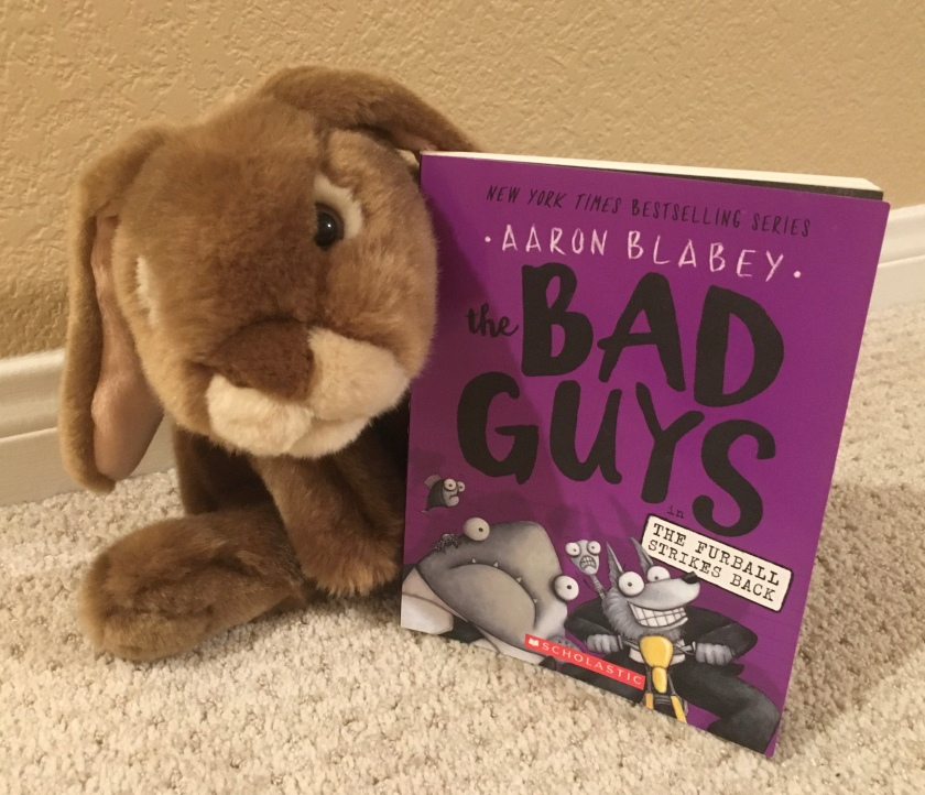 Caramel really enjoyed reading The Bad Guys in The Furball Strikes Back by Aaron Blabey (Bad Guys #3) and is looking forward to reading more about their adventures.