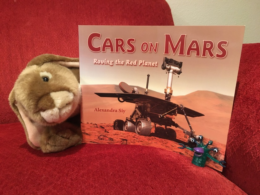 Caramel enjoyed reading Cars on Mars: Roving the Red Planet by Alexandra Siy with a Martian friend. Can you see this little alien?