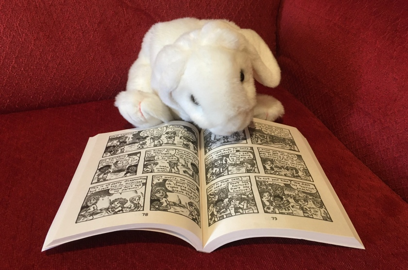 Marshmallow is pointing the reader to the pages of Lucy and Andy Neanderthal: Bad to the Bones (the third book in the Lucy and Andy Neanderthal series) by Jeffrey Brown, where Andy burns things up in order to eradicate lice.