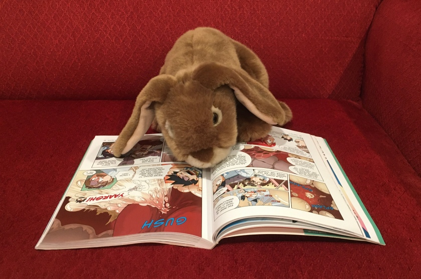 Caramel is reading Survive: The Digestive System, illustrated by Hyun-Dong Han.