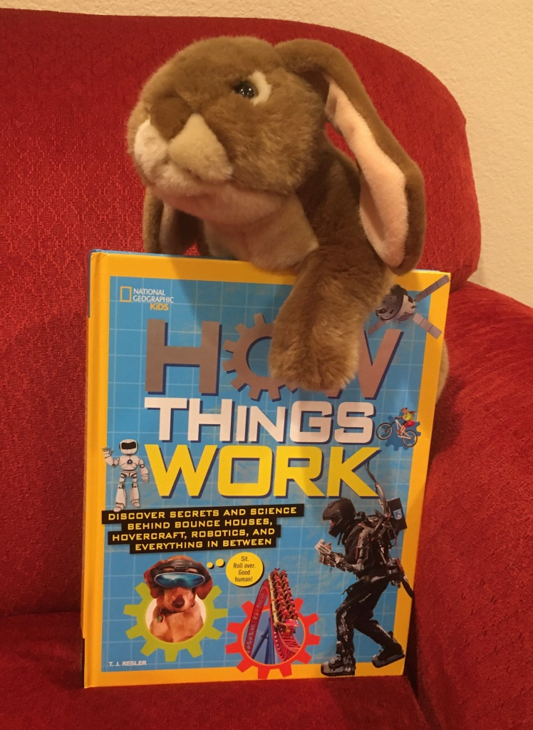 Caramel loved reading and looking at the pictures in How Things Work by T. J. Resler.