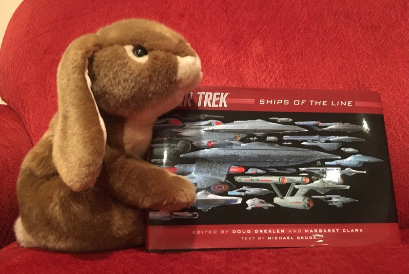 It is clear that Caramel is not done with Star Trek: Ships of the Line, by Doug Drexler, Margaret Clark, and Michael Okuda. He expects that he will read and reread it many more times in the coming weeks and months.