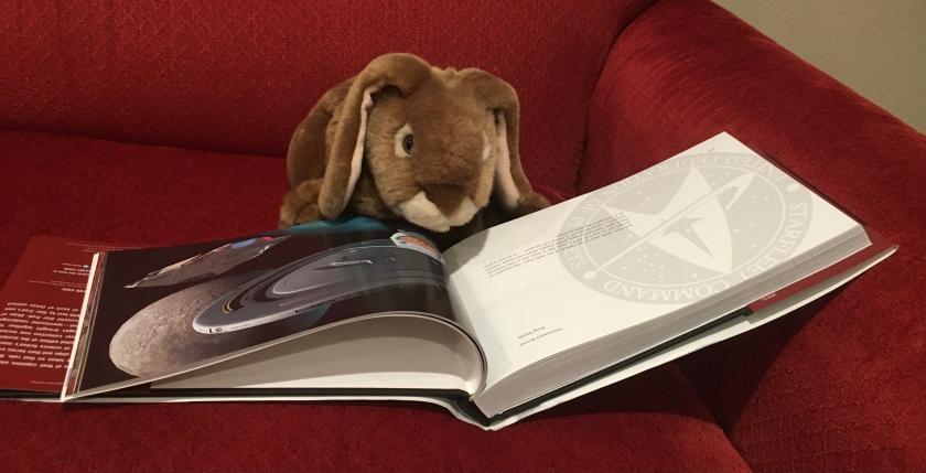 Caramel is checking out USS Voyager and the Delta Flyer in Star Trek: Ships of the Line, by Doug Drexler, Margaret Clark, and Michael Okuda.