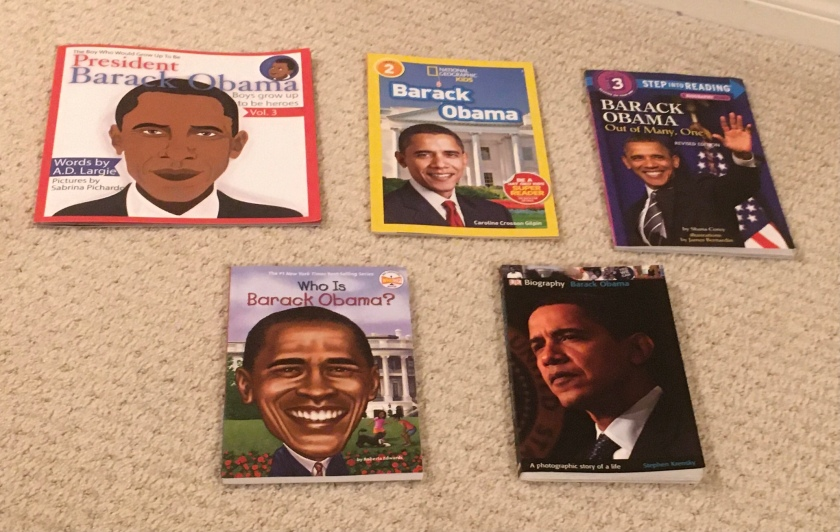 In this photo, Sprinkles organized the books in this review in the order of reader level: President Barack Obama by A.D. Largie and Sabrina Pichardo, Barack Obama by Caroline Crosson Gilpin, Barack Obama: Out of Many, One by Shana Corey and James Bernardin, Who Is Barack Obama? by Roberta Edwards and John O'Brien, and Barack Obama by Stephen Krensky.