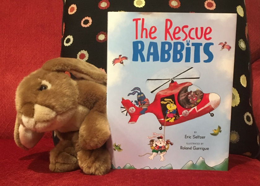 Caramel reviews The Rescue Rabbits written by Eric Seltzer and illustrated by Roland Garrigue.