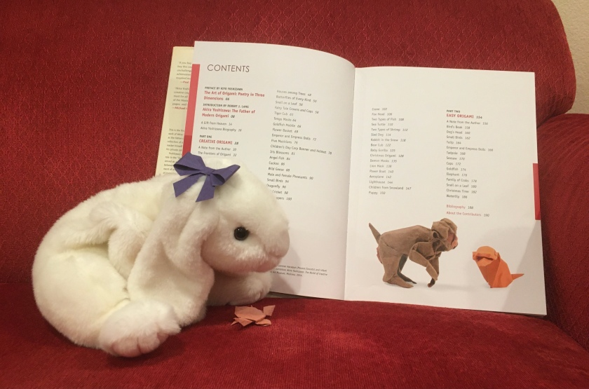 Marshmallow and Turtle are looking at the table of contents of Akira Yoshizawa: Japan's Greatest Origami Master, with text, diagrams, and models by Akira Yoshizawa.