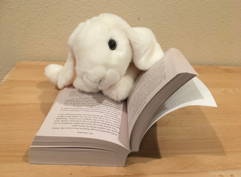 Marshmallow is reading The House of Hades (Book 4 of the Heroes of Olympus Series) by Rick Riordan.