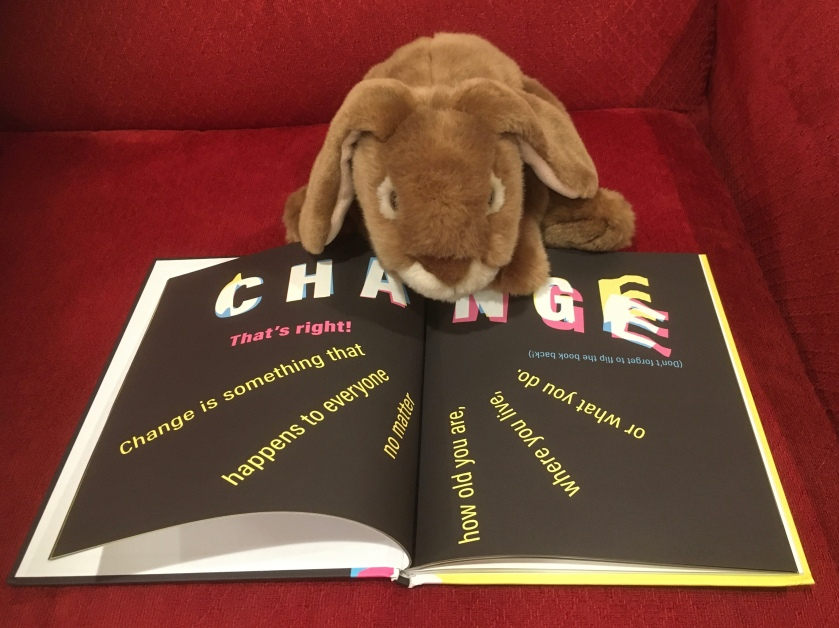 Caramel is reading A Kids Book About Change by David Kim.