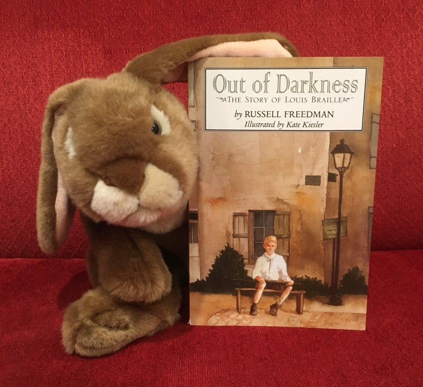 Caramel has appreciated reading Out of Darkness: The Story of Louis Braille, written by Russell Freedman and illustrated by Kate Kiesler, and recommends it to other little bunnies who might like to learn about a young person who overcame big obstacles and achieved great things.