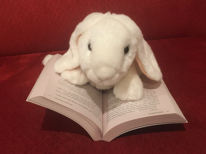 Marshmallow is reading The Dark Prophecy (Book 2 of the Trials of Apollo Series) by Rick Riordan