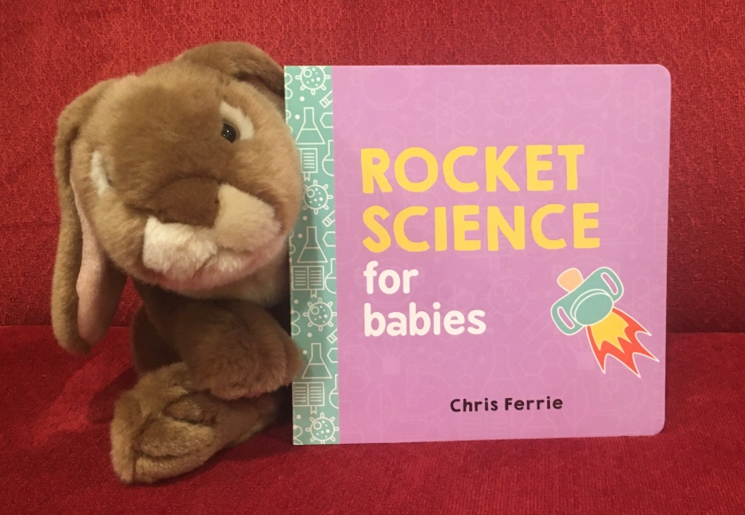 Caramel is posing with Rocket Science for Babies by Chris Ferrie, his favorite so far in this series.