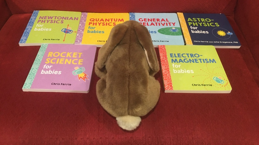 Caramel enjoyed reading and rereading Electromagnetism for Babies, Astrophysics for Babies, Newtonian Physics for Babies, General Relativity for Babies, Quantum Physics for Babies, and Rocket Science for Babies, almost all written by Chris Ferrie, except the astrophysics one which is coauthored by Ferrie and Julia Kregenow.