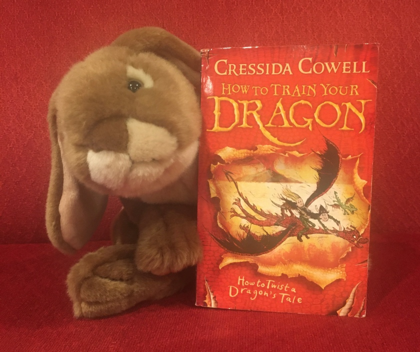 Caramel reviews How to Twist a Dragon's Tale (Book #5 of How to Train Your Dragon Series) by Cressida Cowell.