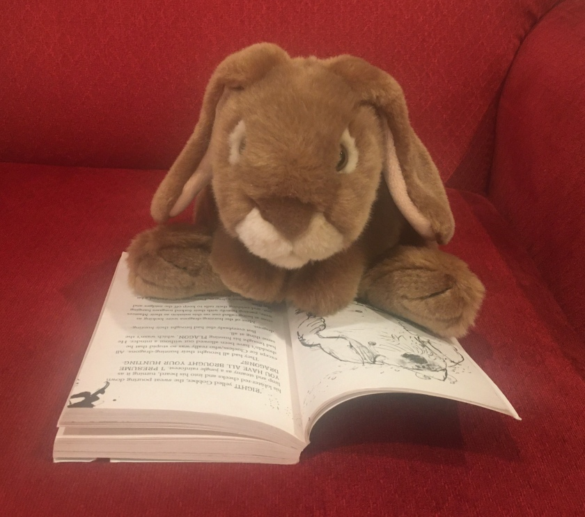 Caramel is reading How to Twist a Dragon's Tale (Book #5 of How to Train Your Dragon Series) by Cressida Cowell.
