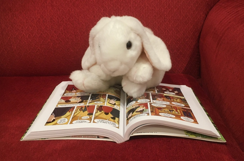 Marshmallow is reading Logicomix, written by Apostolos Doxiadis and Christos H. Papadimitriou, and illustrated by Alecos Papadatos and Annie di Donna.