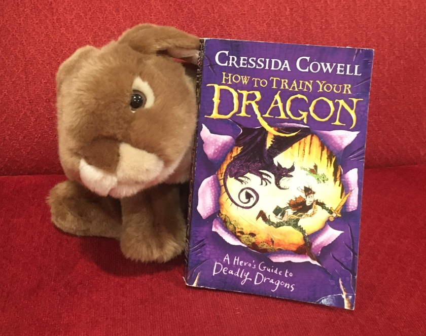Caramel reviews A Hero's Guide to Deadly Dragons (Book #6 of How to Train Your Dragon Series) by Cressida Cowell.
