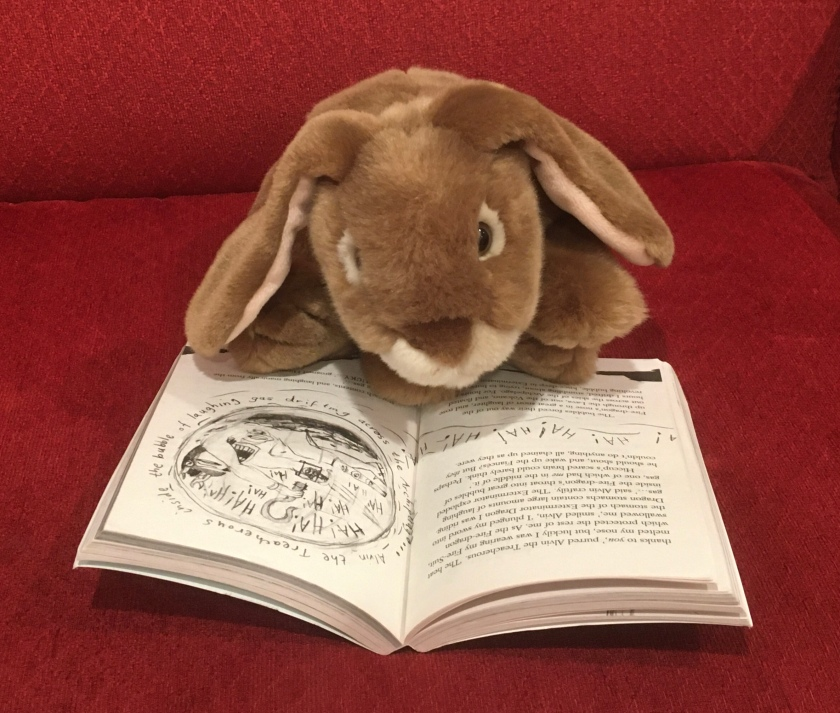 Caramel is reading How To Break A Dragon's Heart (Book #8 of How to Train Your Dragon Series) by Cressida Cowell.