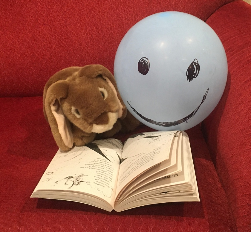 Caramel and Mr. Balloon are reading How To Ride A Dragon's Storm (Book #7 of How to Train Your Dragon Series) by Cressida Cowell.