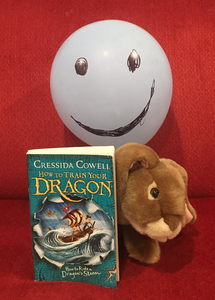 Caramel (and Mr. Balloon) loved reading How To Ride A Dragon's Storm (Book #7 of How to Train Your Dragon Series) by Cressida Cowell, and reviewing it for you.