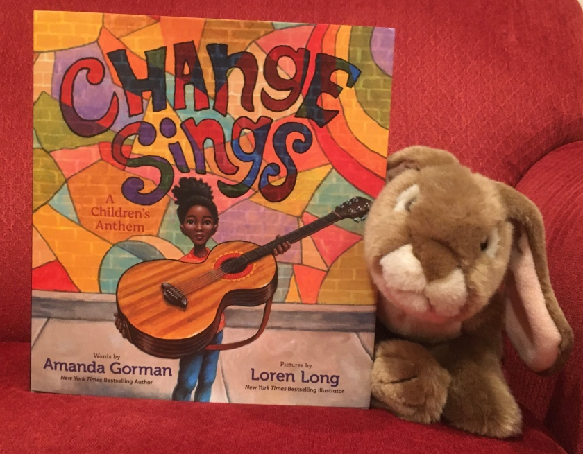 Caramel enjoyed reading Change Sings: A Children's Anthem, written by poet Amanda Gorman and illustrated by Loren Long, and recommends it to little bunnies who enjoy the sound of words and like to think about how they can make the world a better place.
