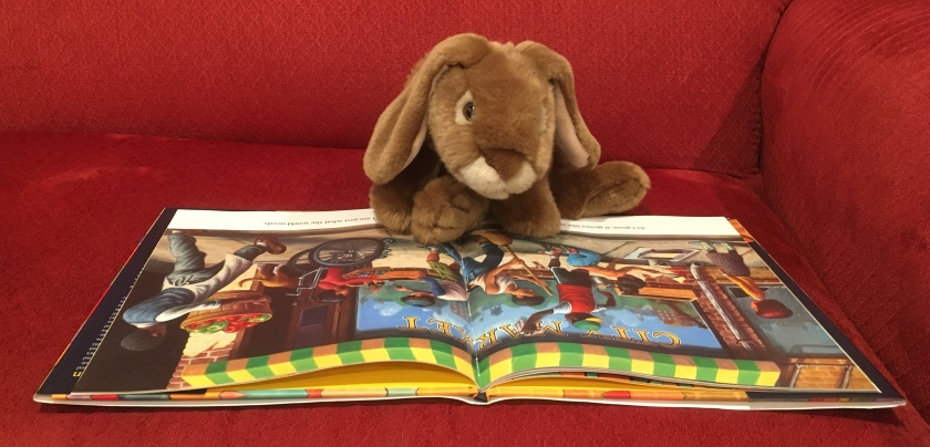 Caramel is reading Change Sings: A Children's Anthem, written by poet Amanda Gorman and illustrated by Loren Long.