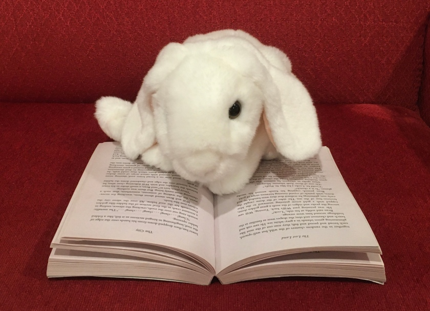 Marshmallow is reading Silver on the Tree by Susan Cooper.